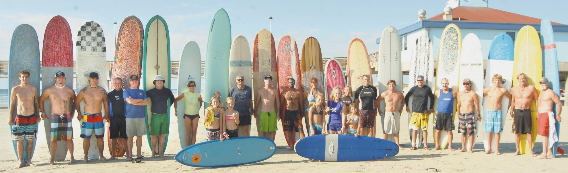 Surfers Paddle To Victory Port Aransas South Jetty